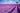 Weitläufiges Lavendelfeld in der Provence mit blauem Himmel und Baum in der Ferne
