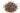 Mehrere kleine dunkle und vereinzelt helle Chiasamen in Nahaufnahme mit weißem Hintergrund
